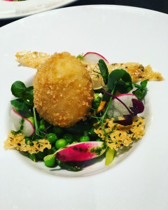 Crispy duck egg with asparagus and broad bean salad